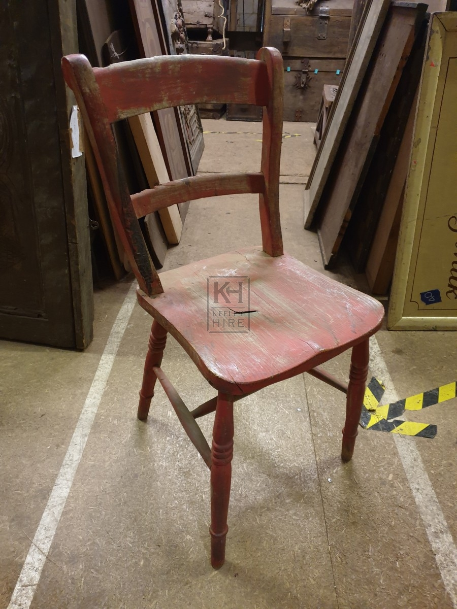 Worn red painted chair