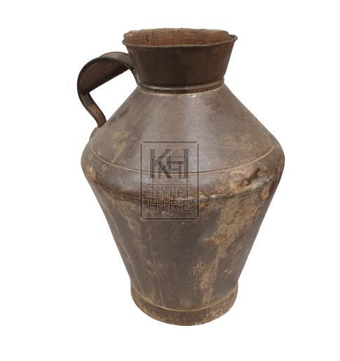 Metal shaped jug with cork