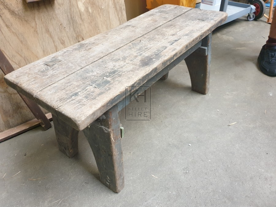 Plain wood bench with arch legs