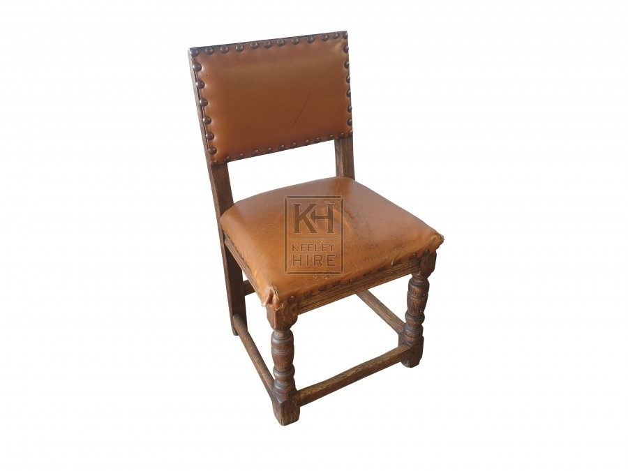 Tan leather studded chair