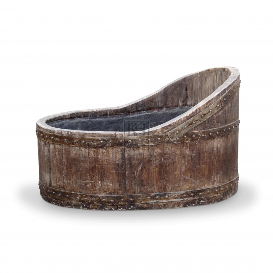 Dark wood bath tub with iron banding