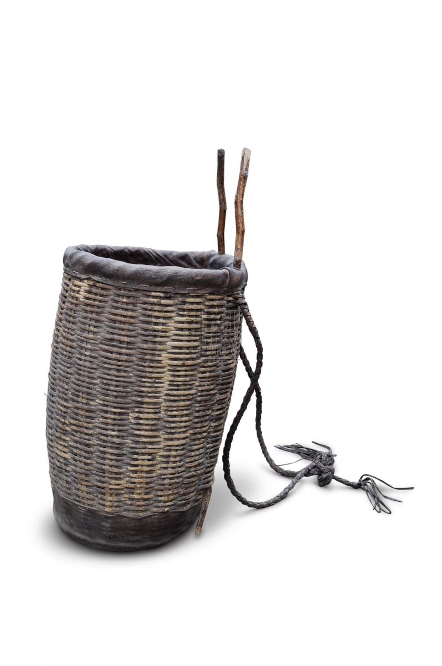 Wicker back basket with braided leather