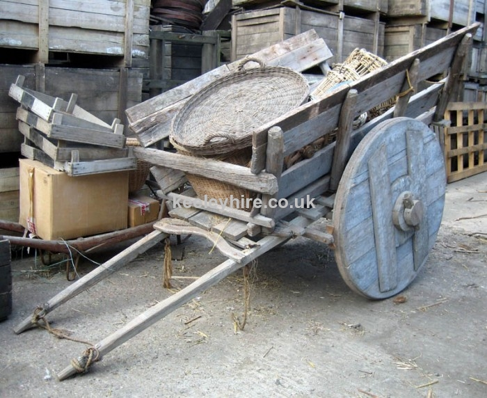 Large early horse cart with solid wheels