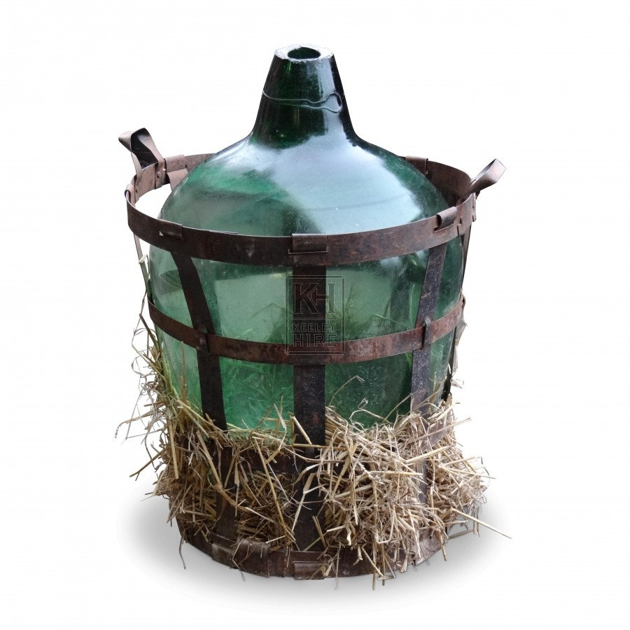 Large bulbous glass bottle in iron cage