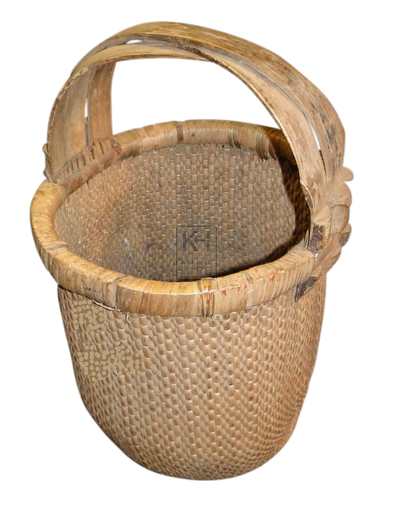 Woven rattan basket with handles