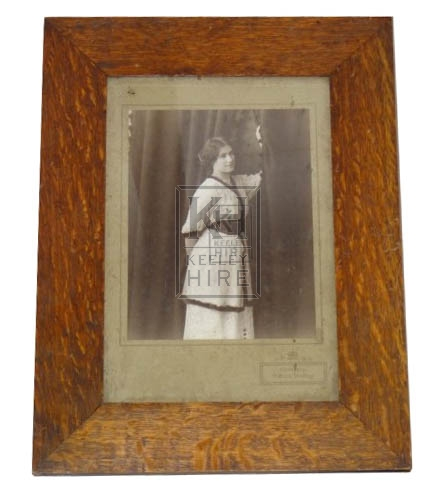 Period photo of lady in wood frame