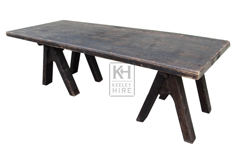 Dark wood table top with trestles