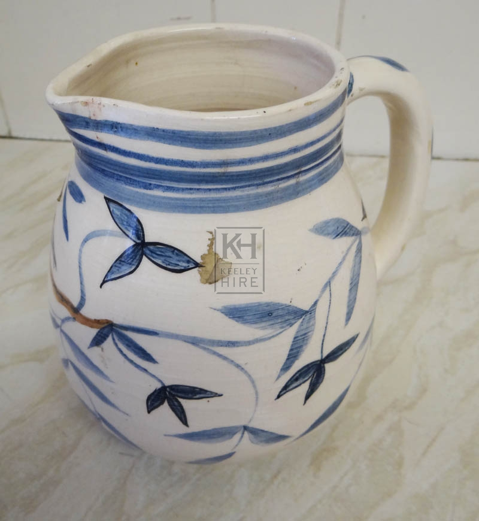 Floral painted delft china jug