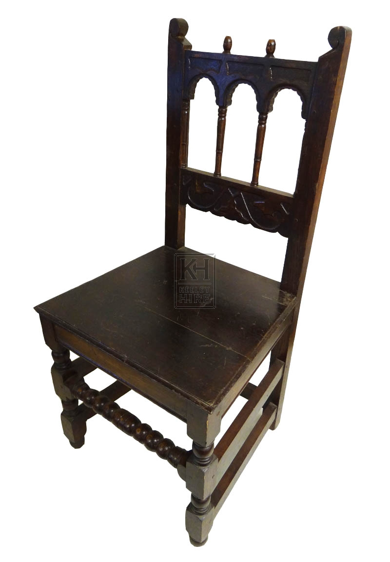 Dark wood polished chair with arches
