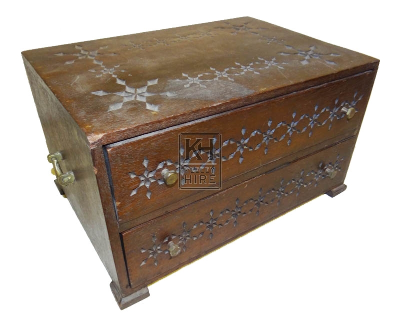 Dark wood carved chest with draws