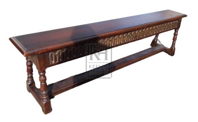 Dark turned leg bench