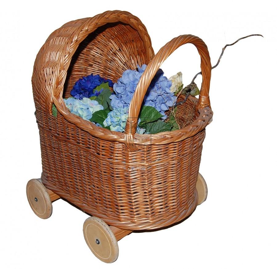 Pram-like basket on wheels with flowers
