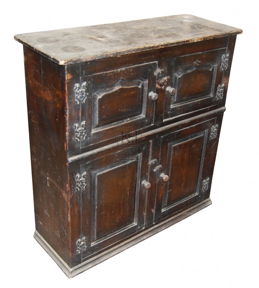 Dark cupboard with intricate hinges