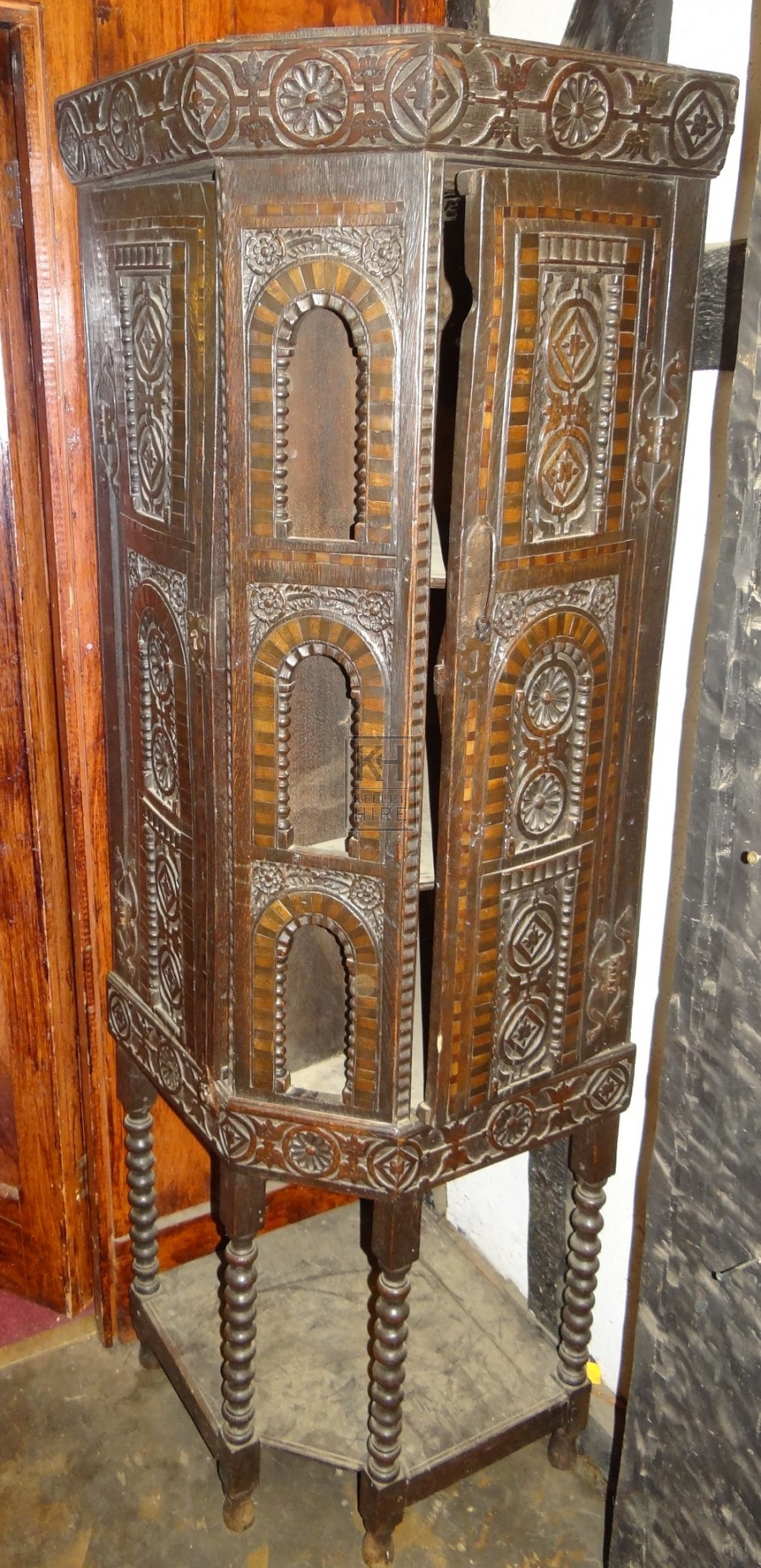 Freestanding carved wood cupboard