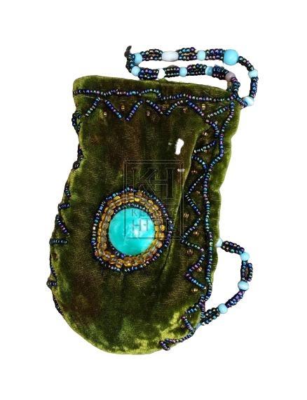Velvet purse with jewel