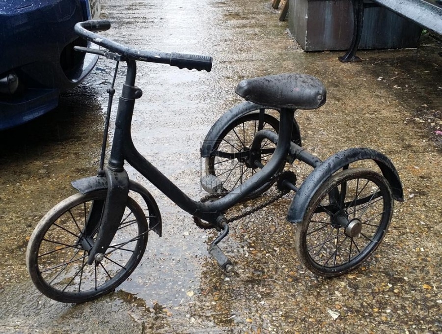 Early childs black tricycle