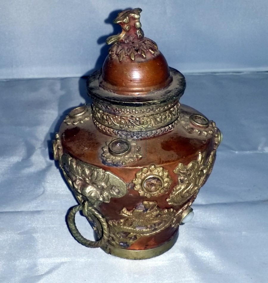 Ornate copper urn with lid