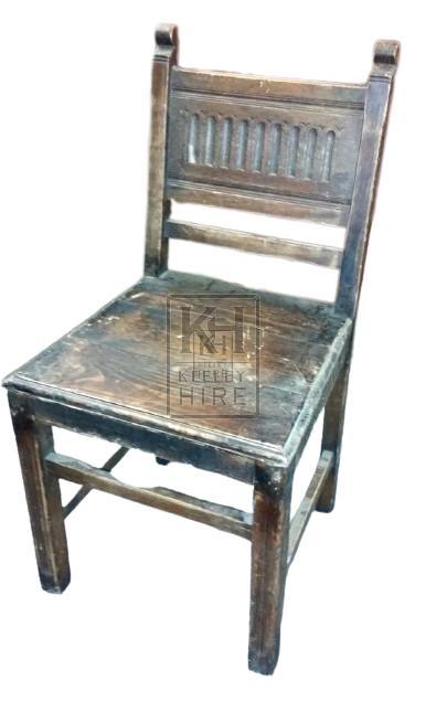 Carved back dark wood chair