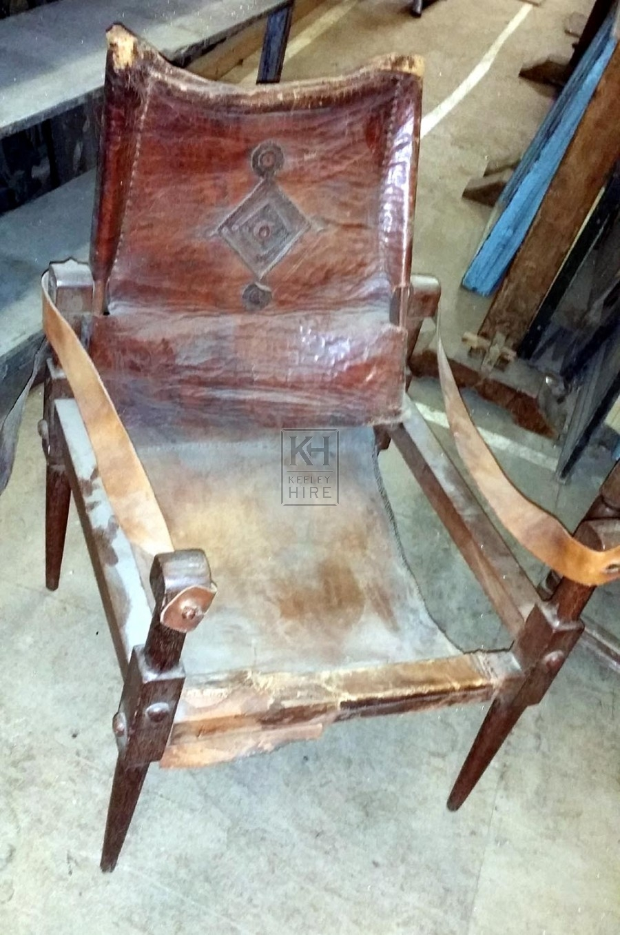 Worn low leather chair