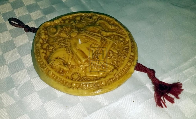 Wax seal on red tassle