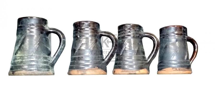 Black glazed earthenware Tankard