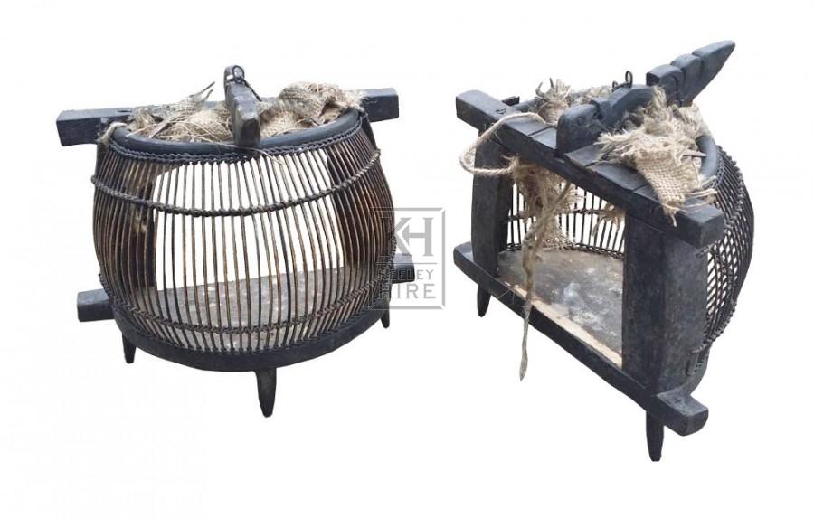 Dark half shaped bird cage