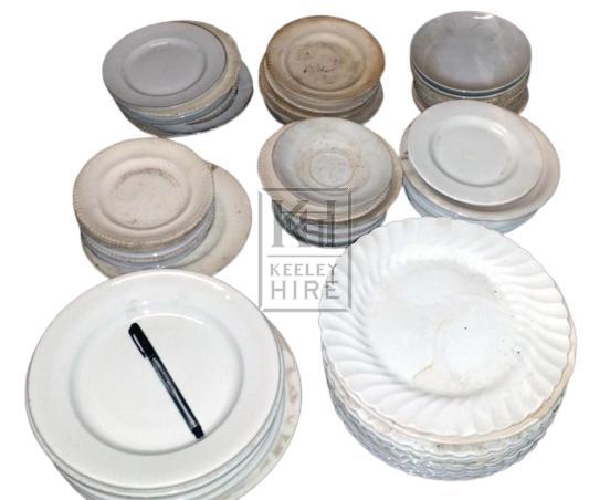 Assorted white china plates