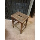 Dark wood stool with shaped hole