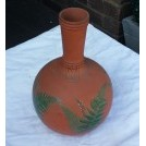 Ceramic bulbous vase with leaf pattern