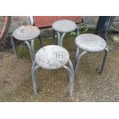 Old weathered round metal stools