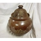 Ornate ceramic pot with lid