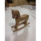 Small carved toy rocking horse