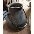 Shaped metal churn with handle