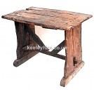 Rough wood table with diagonal braces