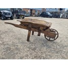 Red painted wood wheelbarrow