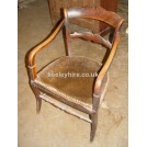 polished wood chair with leather seat