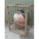 Very large earthenware urn in wood frame