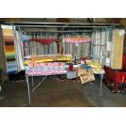 Metal market stall dressed - fabrics