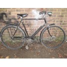 Gents black bicycle with carrier & light