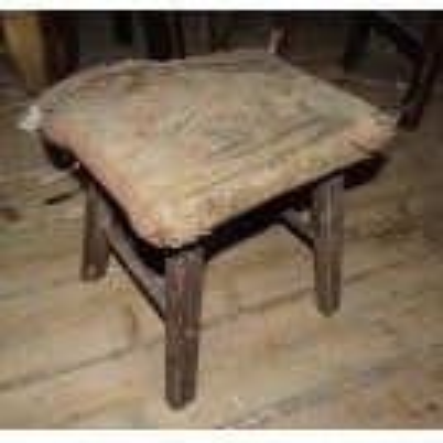 Very tatty upholstered stool