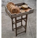 Street traders stand with bread & pies