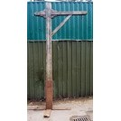 Tall wood post with iron ring