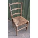 Shaped ladder back straw seat chair