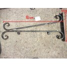 Iron sign bracket with facing scrolls