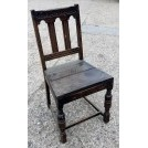 Dark wood chair with arches