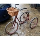 Early red childs tricycle with basket