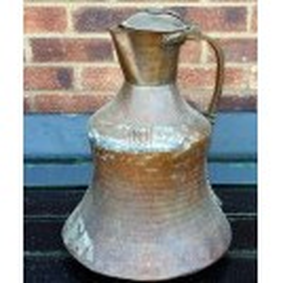 Large shaped copper jug