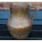 Wide bulbous copper jug
