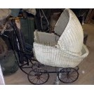Tatty white wicker childs pram