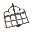 Ornate shaped wall hanging candle holder